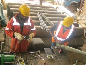 Atprojects Engineer, Nagasi Namui and Bob Abio Atprojects Welder/ Electrician preparing the hand rail support post for the bridge